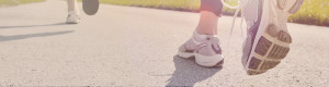 Close Up of Runner's Shoes on Paved Trail