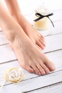 Bare Feet Next to Candle and Beige Rose Soap