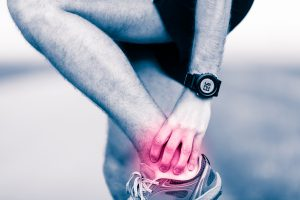 Runner Holding Ankle in Pain Copy 3