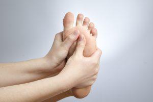 Hands Massaging Bottom of Foot Copy