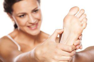 Female Model Massaging Plant of Foot Copy
