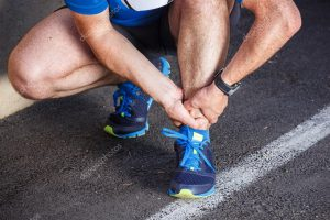 Male Runner Grasping Ankle in Pain Copy