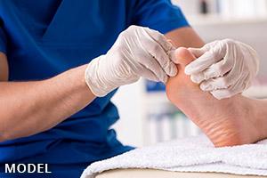 podiatrist treating patient